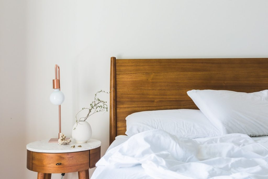 japandi wooden bed and bedside table
